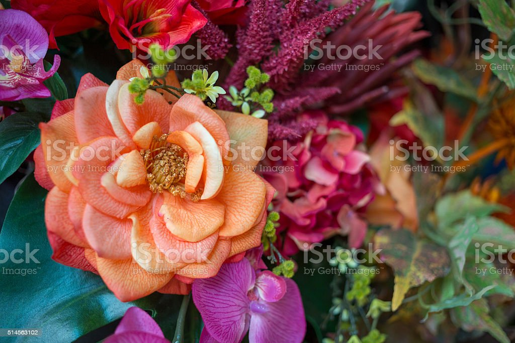 Colorful bouquet of artificial flowers with different blossoms stock photo