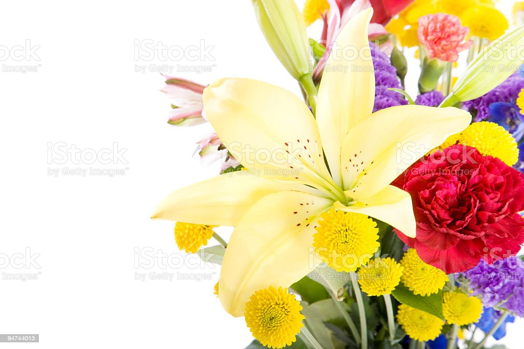 A colorful bouquet of yellow, red and purple flowers stock photo