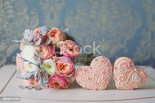 istock Colorful bouquet, wedding rings and two decorated beautiful honey cakes. 584874244