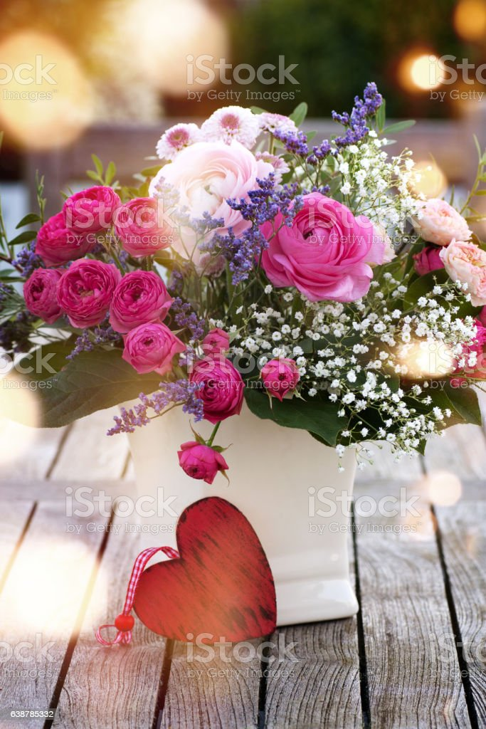 Colorful bouquet with a heart stock photo