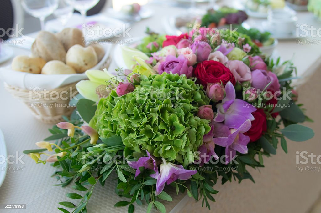 Colorful bouquet with roses and ranunkulus stock photo