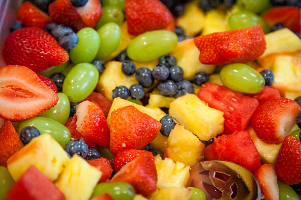 Colorful Bowl of Cut Up Fruit stock photo