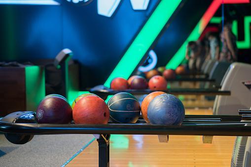 Colorful bowling balls at bowling club.