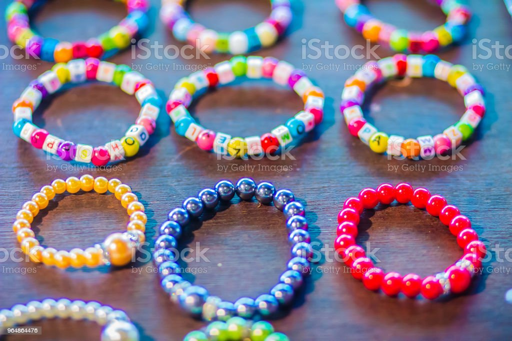 Colorful bracelet for sale. Vivid handmade raided bracelets on the market. royalty-free stock photo