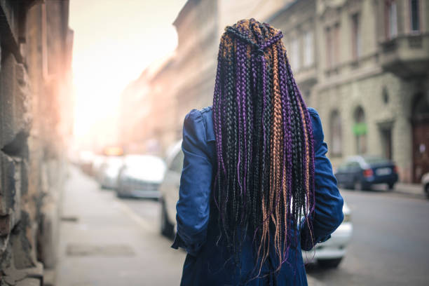Colorful, braided hair stock photo