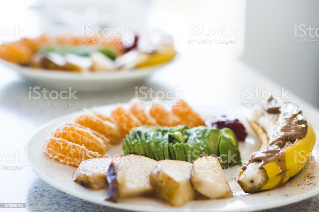 Colorful breakfast of various fruits stock photo