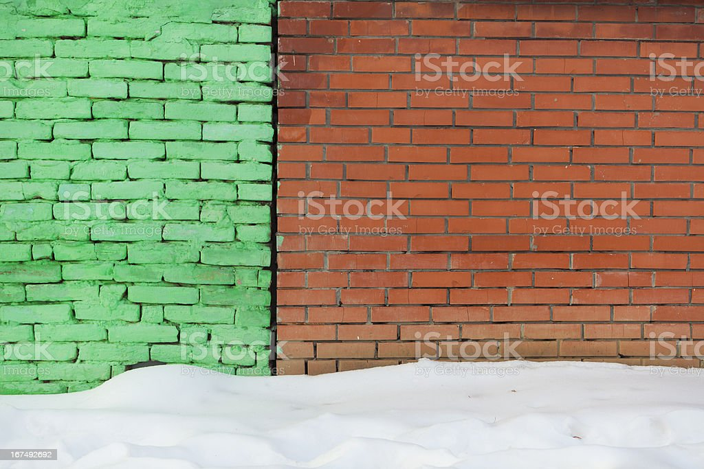 Colorful brick wall and snow royalty-free stock photo