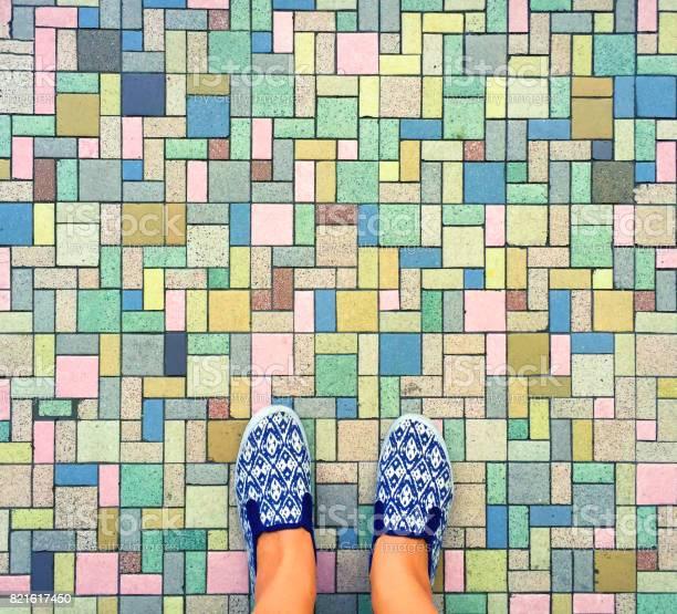 Colorful bricks background and female feet womans legs in white and picture id821617450?b=1&k=6&m=821617450&s=612x612&h=u  jcal31b mpwyak4fufjiigvenesibcuwmjkcv ys=