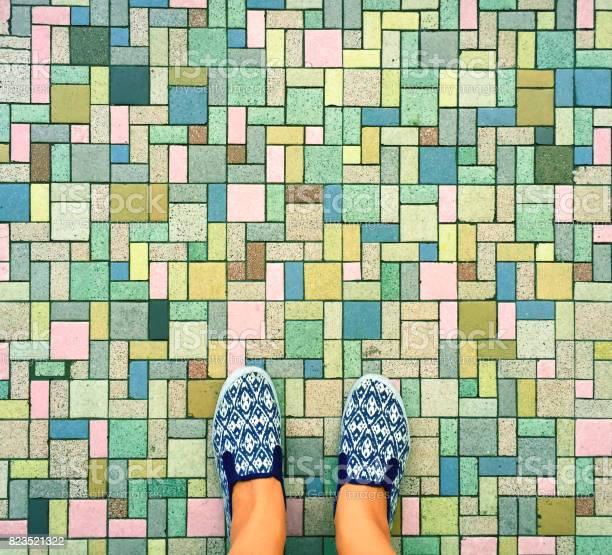 Colorful bricks background and female feet womans legs in white and picture id823521322?b=1&k=6&m=823521322&s=612x612&h=j6y7yclknmoj7wh ry3f2gsw6mw8vjitbqcxninebbe=
