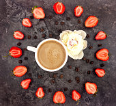 Colorful bright composition of coffee cup, strawberries and peony flower