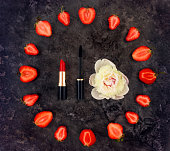 istock Colorful bright composition of make up accessories, strawberries and peony flower. Flat lay, top view 668133680