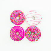 istock Colorful bright donuts on white background. Delicious food.  Flat lay, top view 866703012