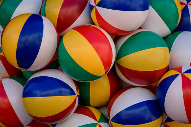 colorful bright striped balls for kids - beach ball stock photos and pictures