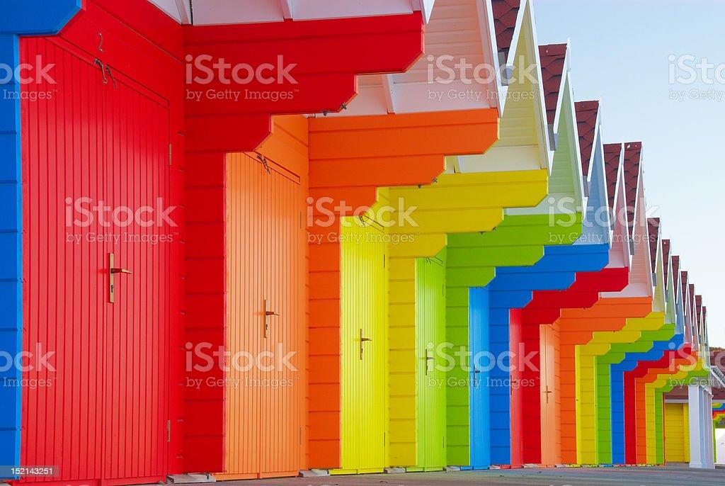 Colorful british beach huts stock photo