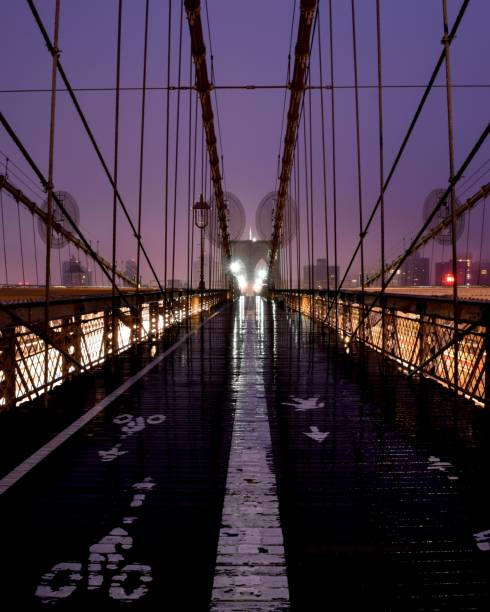 Colorful Brooklyn Bridge at Night in the Rain stock photo