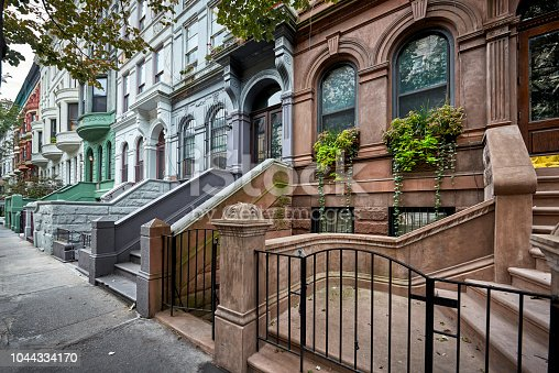 istock colorful brownstones 1044334170