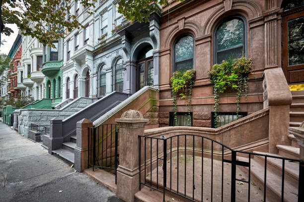 colorful brownstones - terraced houses stock photos and pictures