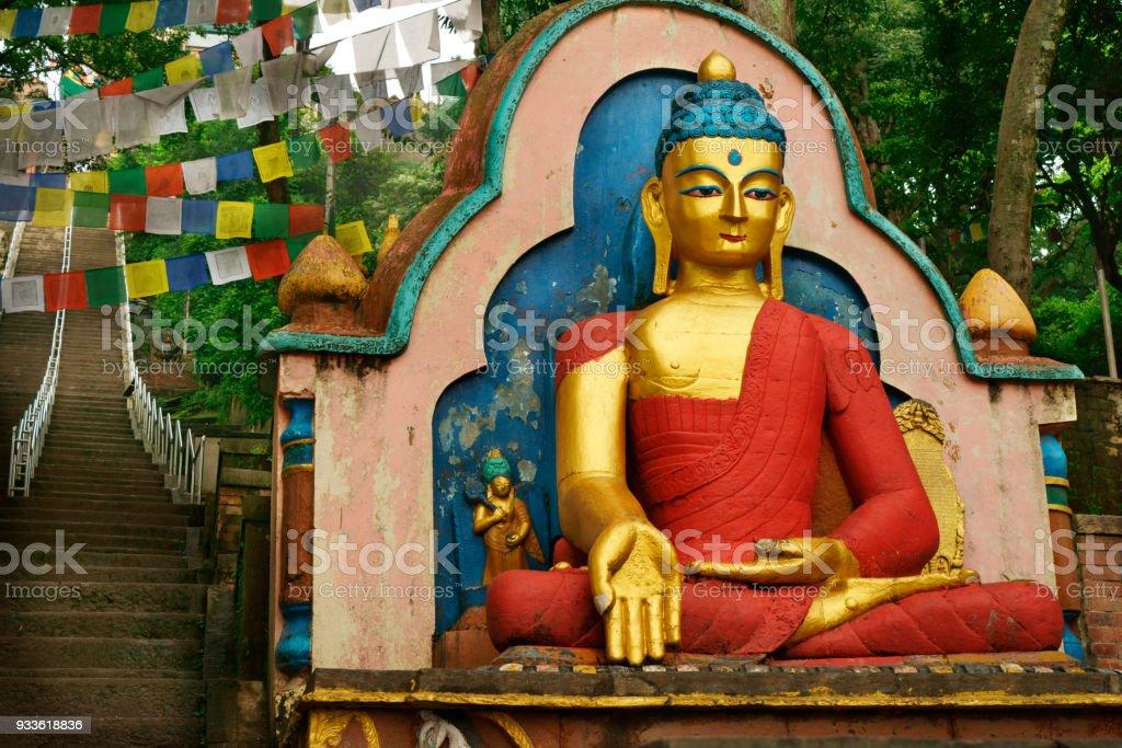 colorful buddha statue and stairs at famous Swayambhunath temple Kathmandu stock photo