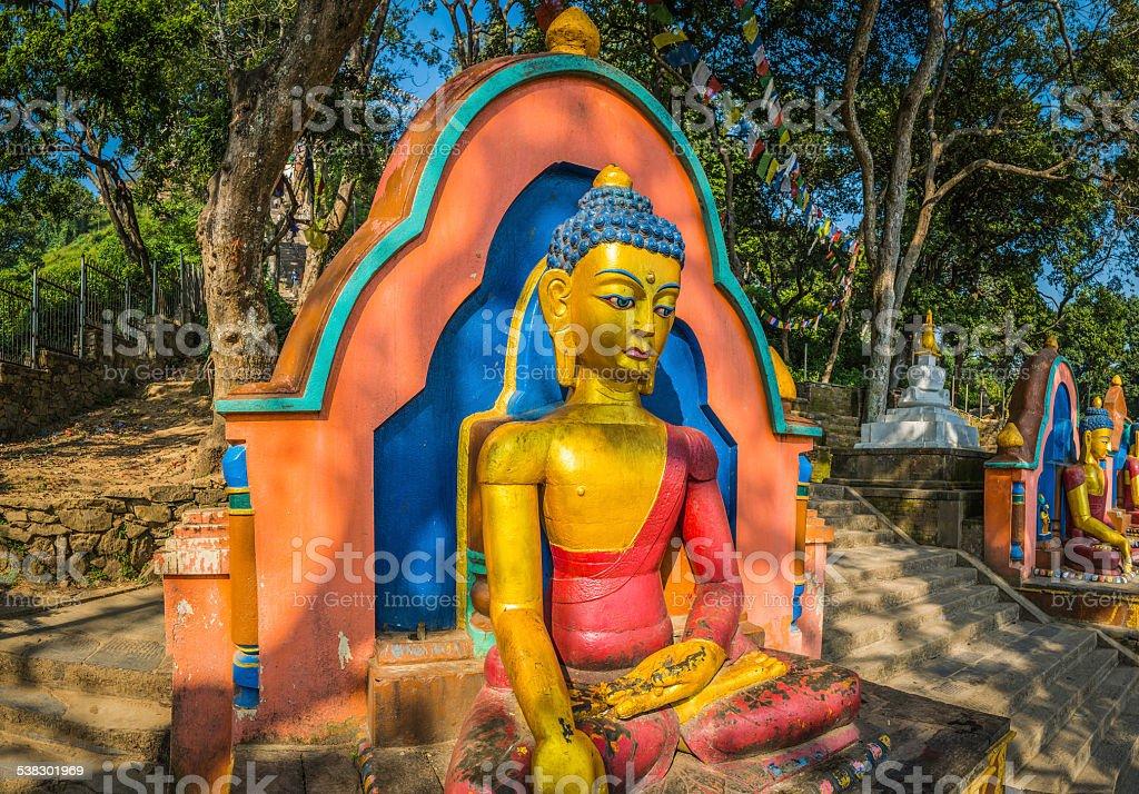 Colorful Buddha statue on steps of Swayambhunath monkey temple Kathmandu stock photo