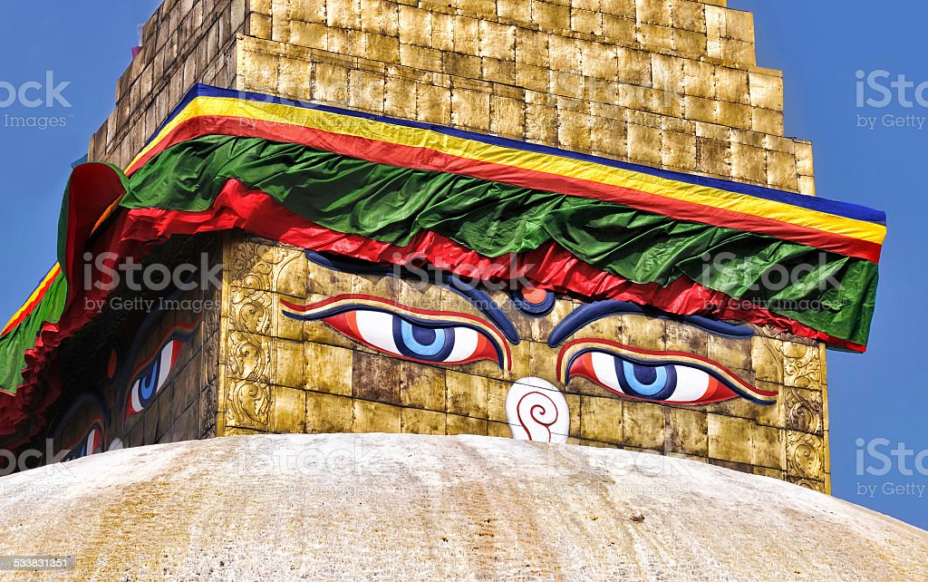 Colorful buddhist pagoda in Nepal with Buddha's eyes of wisdom stock photo