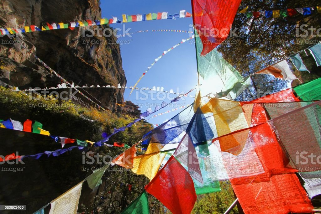 Colorful Buddhist prayer flags at Taktshang Goemba or Tiger's nest monastery in Paro, Bhutan stock photo