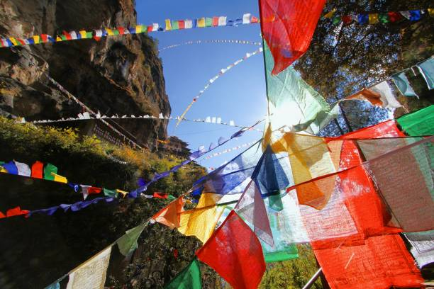Colorful Buddhist prayer flags at Taktshang Goemba or Tiger's nest monastery in Paro, Bhutan Colorful Buddhist prayer flags at Taktshang Goemba or Tiger's nest monastery in Paro, Bhutan bodhisattva stock pictures, royalty-free photos & images