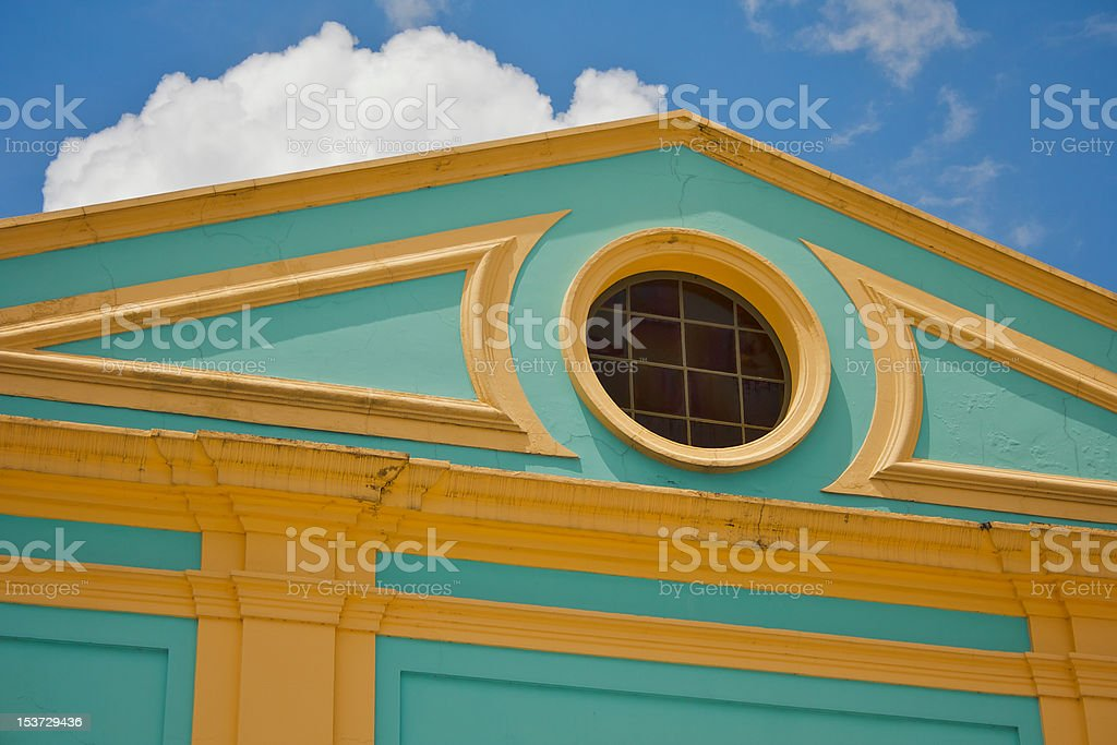 Colorful building detail with round window royalty-free stock photo