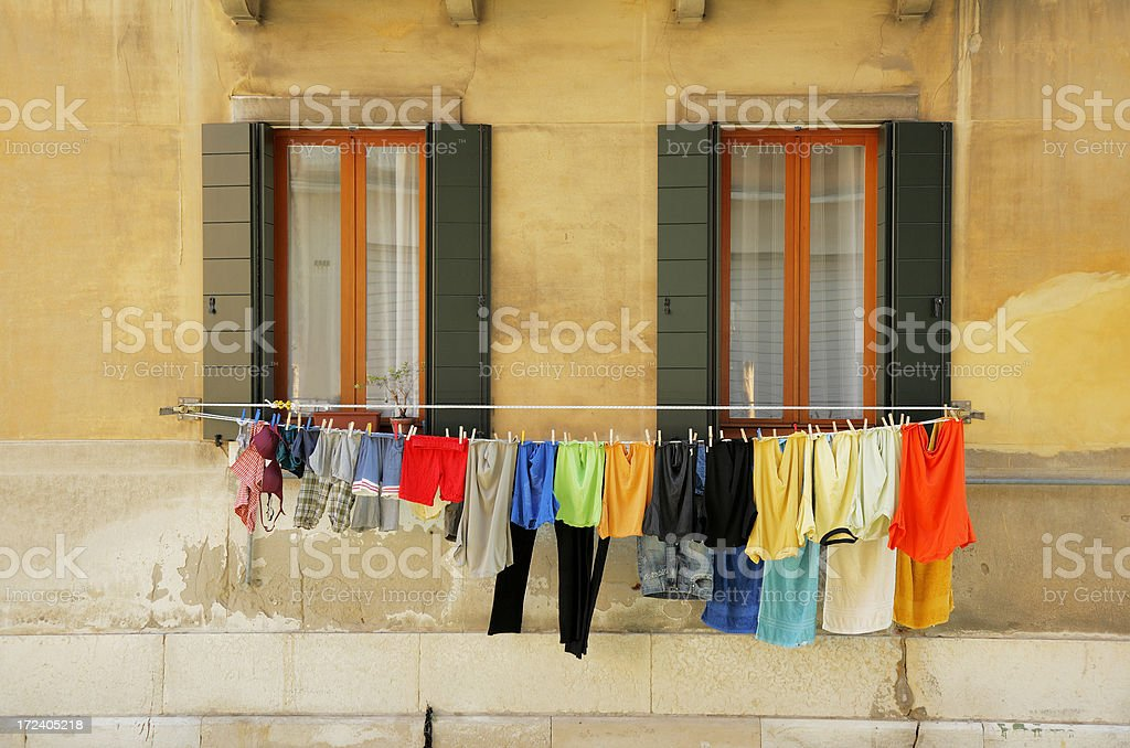 Colorful building exterior and hanging laundry in Croatia. stock photo