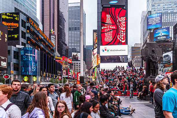 colorful building signs in times square - times square stock photos and pictures