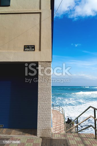 istock Colorful buildings and atlantic ocean in a spanish town Punto Brava, Tenerife, Canary islands, Spain. 1253718490