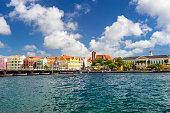 Curacao, Netherlands Antilles - December 29, 2016: Colorful buildings and blue sky in the harbor of Willemstad