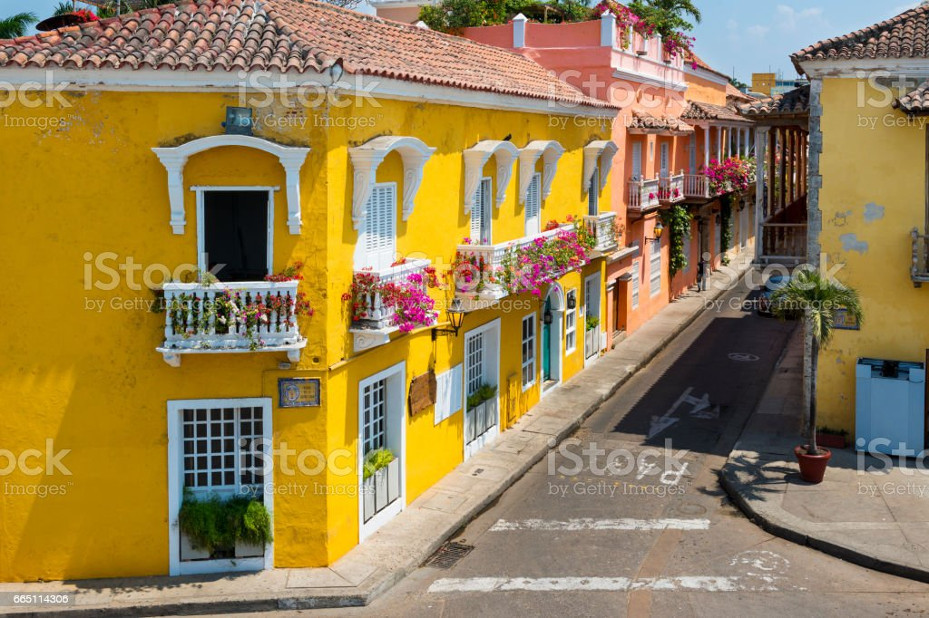 Colorful buildings in a street of the old city of Cartagena (Cartagena de Indias) in Colombia stock photo