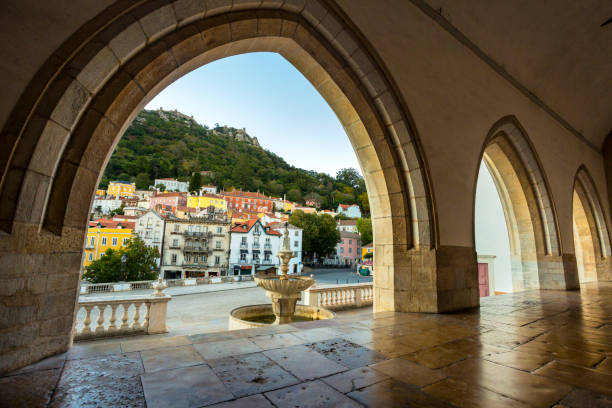 Colorful buildings in old town of Sintra with frame of gothic arches. stock photo