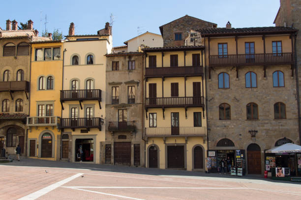 Colorful buildings in Piazza Grande in Arezzo, Tuscany, Italy. Italy, Arezzo - March 12 2017: the view of the colorful buildings in Piazza Grande in Arezzo on March 12 2017, Tuscany, Italy. piazza grande stock pictures, royalty-free photos & images