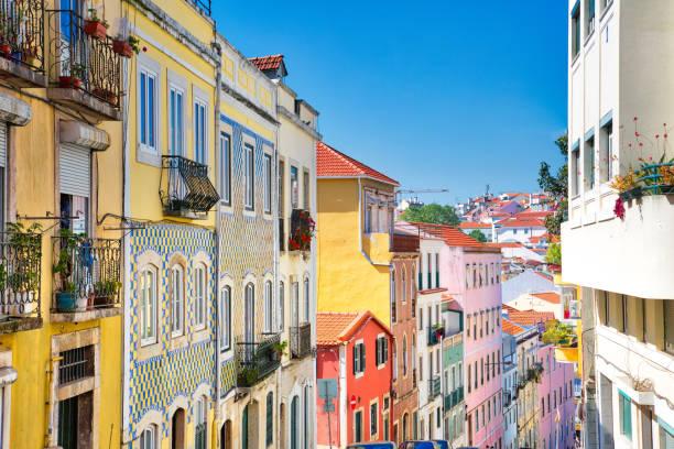 colorful buildings of lisbon historic center near landmark rossio square - lisbona foto e immagini stock