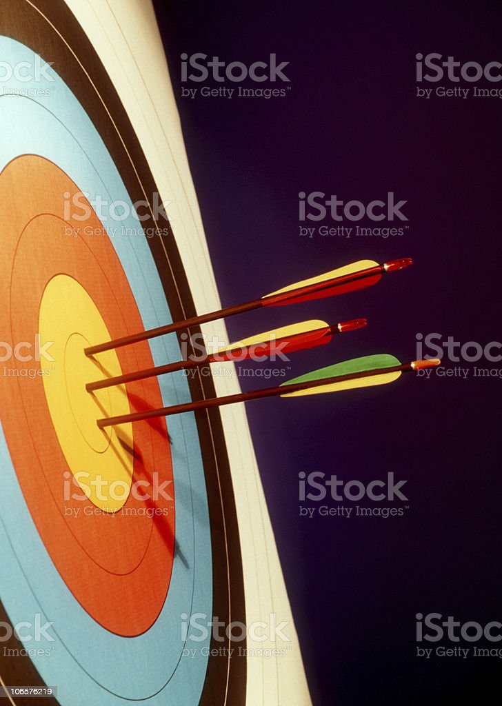 Colorful bulls eye target with three arrows in the center stock photo