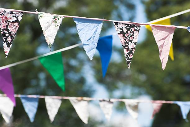 Colorful bunting with patterned fabric strung up outside stock photo