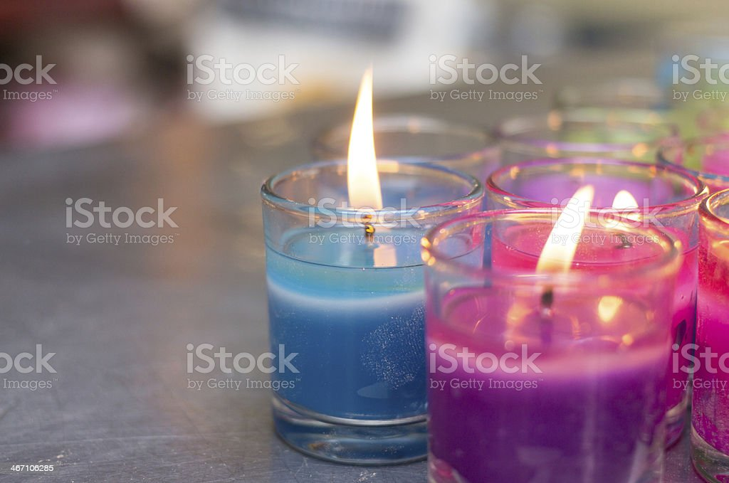 colorful burning candle in glasses stock photo