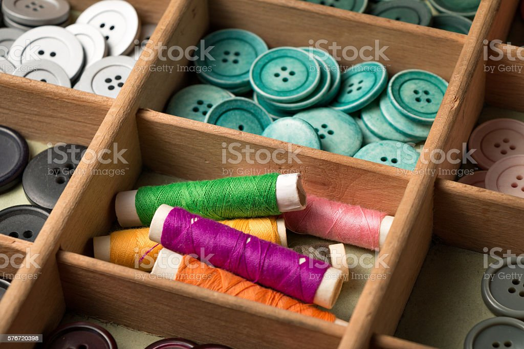 Colorful buttons in a box stock photo