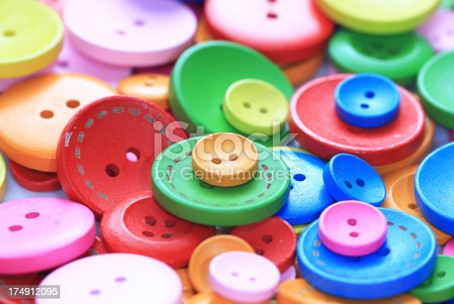 537376226istockphoto Colorful buttons 174912095