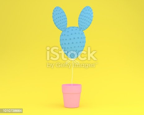 istock Colorful cactus rabbit with flower pot on pastel yellow background. minimal idea concept. 1010738664