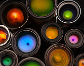 A shot of lens elements with a lot of color.  Camera lenses.