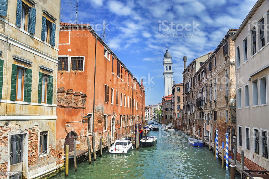 Colorful canal Venice with Boats and Church in Backgraund royalty-free stock photo