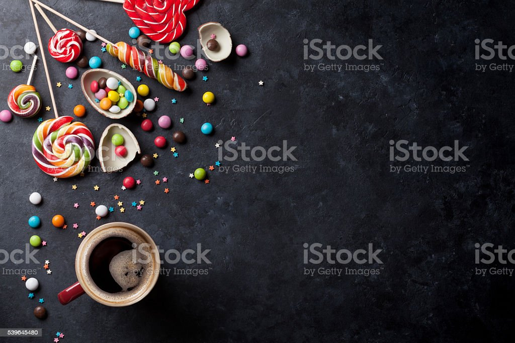 Colorful candies and coffee cup stock photo