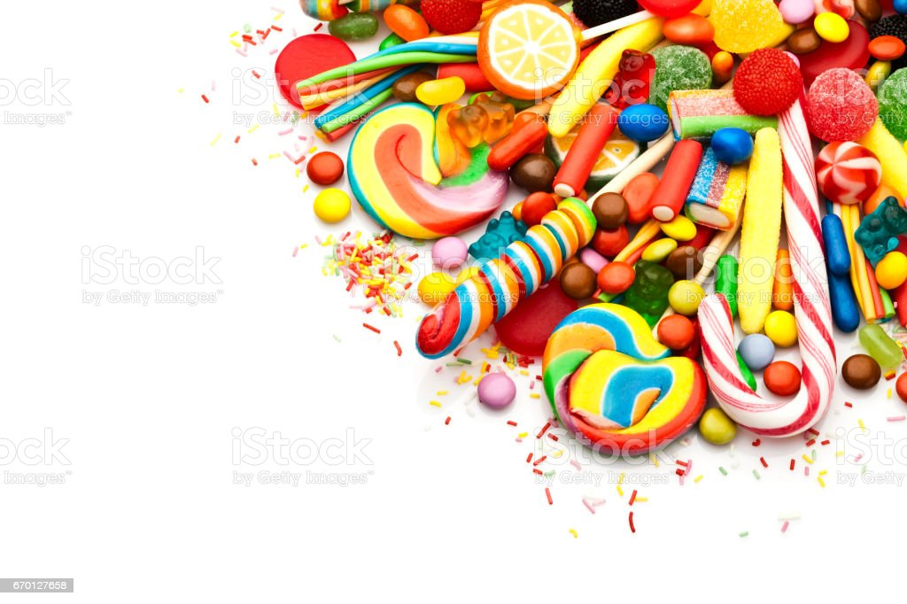 Colorful candies corner on white background stock photo