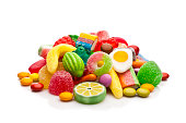 Colorful candies heap isolated on white background