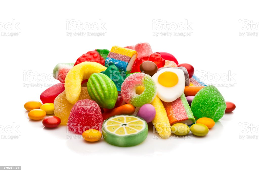 Colorful candies heap isolated on white background stock photo