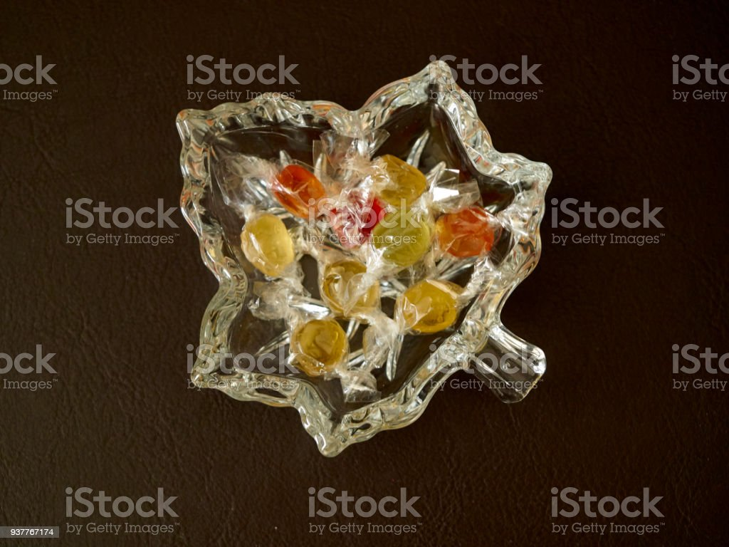Colorful candies in a glass tray stock photo