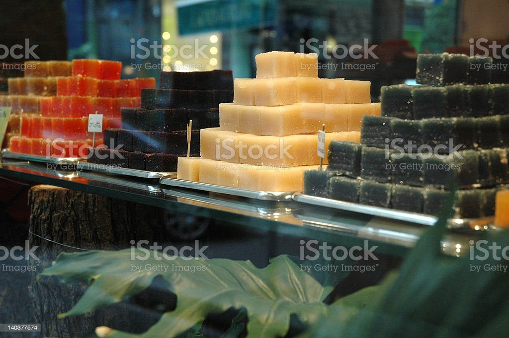 Colorful candies in window of French shop stock photo