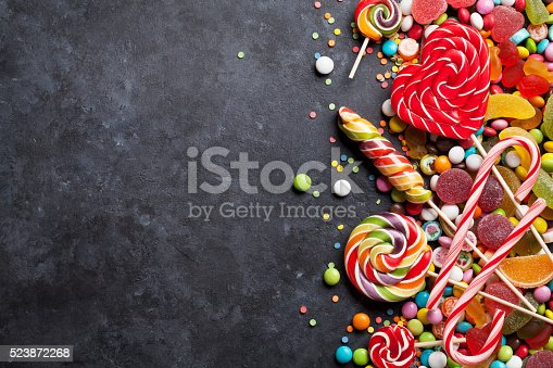 istock Colorful candies, jelly and marmalade over stone 523872268